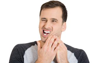 A man holds his jaw in pain | Dental Emergency Hartford CT