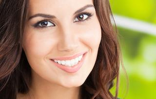a woman smiles | hartford ct dental extraction