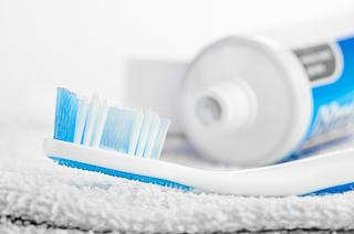 A toothbrush and tooth paste sit on a towel | Preventive dentist hartford ct